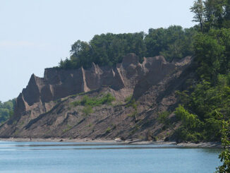 The 597-acre, minimally developed Chimney Bluffs State Park lies along Lake Ontario's shoreline and features numerous tall pillars of rock for which it was named.