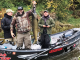 Jan Hrdlicka (front center) holds a Chinook salmon on the Oswego River. Looking on are Olaf Jochmann, back left and Capt. Kevin Davis, right. Photos courtesy of Catch the Drift and Chasin' Tail Adventures guide services.